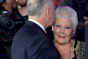 Judi Dench (R) embraces David Parfitt at the 'Red Joan' premiere and Golden Icon Award during the 14th Zurich Film Festival at Festival Centre on October 03, 2018 in Zurich, Switzerland.