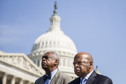 (L-R) Wade Henderson, president of the Leadership Conference on Civil and Human Rights, and Rep. John Lewis (D-GA) look on during a news conference in support of the Voting Rights Amendment Act, on Capitol Hill, June 24, 2014 in Washington, DC. On Wednesday, the Senate Judiciary Committee is scheduled to hold a hearing on the Voting Rights Amendment Act of 2014.