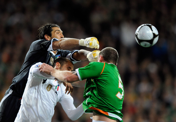 Gianluigi Buffon and Giorgio Chiellini of Italy and Richard Dunne of Ireland in action during the FIFA 2010 World Cup Group 4 Qualifying match between Republic of Ireland and Italy at Croke Park Stadium on October 10, 2009 in Dublin, Ireland.