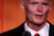 Florida Governor Rick Scott delivers a speech on the third day of the Republican National Convention on July 20, 2016 at the Quicken Loans Arena in Cleveland, Ohio. Republican presidential candidate Donald Trump received the number of votes needed to secure the party's nomination. An estimated 50,000 people are expected in Cleveland, including hundreds of protesters and members of the media. The four-day Republican National Convention kicked off on July 18.