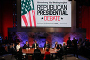 (L-R) Jon Huntsman, U.S. Rep. Michele Bachmann (R-MN), Texas Gov. Rick Perry, Herman Cain, Mitt Romney, U.S. Rep. Ron Paul (R-TX), Rick Santorum and Newt Gingrich participate in the Republican Presidential debate hosted by Bloomberg and the Washington Post on October 11, 2011 at Dartmouth College in Hanover, New Hampshire. Eight GOP candidates met for the first debate of the 2012 campaign focusing solely on the economy.