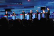 Republican presidential candidates (L-R) former U.S. Senator Rick Santorum (R-PA), Texas Gov. Rick Perry, former Massachusetts Gov. Mitt Romney, former Speaker of the House Newt Gingrich, U.S. Rep. Ron Paul (R-TX), U.S. Rep. Michele Bachmann (R-MN), and former Utah Governor Jon Huntsman Jr. field questions during the Fox News Channel debate at the Sioux City Convention Center on December 15, 2011 in Sioux City, Iowa. The GOP contenders are in the final stretch of campaigning in Iowa where the January 3rd caucus is the first test the candidates must face before becoming the Republican presidential nominee.