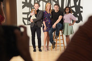 (L-R) TV personalities Noah Levy, Marianne Garvey, Rob Shuter and Delaina Dixon pose for the Resident Magazine cover shoot of the hosts of VH1's 'The Gossip Table' on September 17, 2014 at Woodward Gallery in New York City.