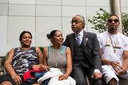 (L-R) Erica Garner, daughter of the late Eric Garner; Esaw Garner, widow of Eric Garner; and Rev. Al Sharpton speak with each other before meeting with Department of Justice officials, June 21, 2017 in the Brooklyn borough of New York City. The family was expected to receive a status report on the progress of the civil rights investigation into Eric Garner's police-involved choking death.