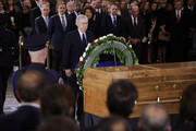 Senate Majority Leader Mitch McConnell (R-KY) presents a wreath next to the casket of Christian evangelist and Southern Baptist minister Billy Graham as he lies in honor in the U.S. Capitol Rotunda February 28, 2018 in Washington, DC. A spiritual counselor for every president from Harry Truman to Barack Obama and other world leaders for more than 60 years, Graham died February 21 at the age of 99.