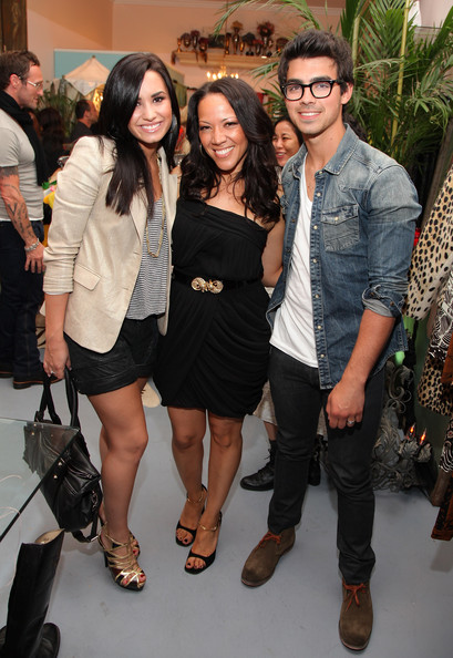 Demi Lovato, Revival proprietor Nikki Swasey and Joe Jonas attend the grand opening of Revival Vintage on April 28, 2010 in Los Angeles, California.