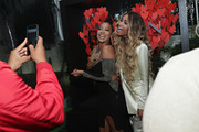 TV personality La La Anthony and singer Ciara attend the Revlon x Ciara launch event at Refinery Hotel on October 18, 2016 in New York City.