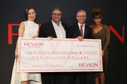 Revlon Global Brand Ambassador Olivia Wilde, Revlon CEO, Lorenzo Delpani, Dr. Jose Baselga, Physician-in-Chief and Chief Medical Officer of Memorial Sloan Kettering, and Revlon Global Brand Ambassador Halle Berry, celebrate the Revlon LOVE IS ON Million Dollar Challenge at the Rainbow Room on November 18, 2015 in New York City.