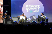 """Pierre """"Pee"""" Thomas, Kevin """"Coach K"""" Lee, and 2 Chainz speak onstage during day 2 of REVOLT Summit x AT&T Summit on September 13, 2019 in Atlanta, Georgia."""