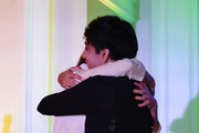 Brigette Lundy-Paine (L) hugs honoree Nik Dodani onstage at the closing night gala and Visibility Awards during Revry's 4th Annual QueerX Festival at The London West Hollywood on June 02, 2019 in West Hollywood, California.