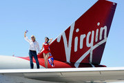 Founder and President of Virgin Group Sir Richard Branson (L) and burlesque artist Dita Von Teese appear on the wing of a Virgin Atlantic Airways 747-400 aircraft at McCarran International Airport June 15, 2010 in Las Vegas, Nevada. Branson is celebrating his British airline's 10th anniversary of flying between London and Las Vegas.