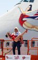 Founder and President of Virgin Group Sir Richard Branson holds burlesque artist Dita Von Teese as they appear on a lift in front of a painting of Von Teese on the side of a Virgin Atlantic Airways 747-400 aircraft at McCarran International Airport June 15, 2010 in Las Vegas, Nevada. Branson is celebrating his British airline's 10th anniversary of flying between London and Las Vegas.