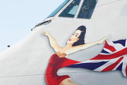 Founder and President of Virgin Group Sir Richard Branson holds burlesque artist Dita Von Teese as they appear on a lift in front of a painting of Teese on the side of a Virgin Atlantic Airways 747-400 aircraft at McCarran International Airport June 15, 2010 in Las Vegas, Nevada. Branson is celebrating his British airline's 10th anniversary of flying between London and Las Vegas.