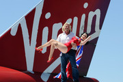 Founder and President of Virgin Group Sir Richard Branson holds burlesque artist Dita Von Teese as they appear on the wing of a Virgin Atlantic Airways 747-400 aircraft at McCarran International Airport June 15, 2010 in Las Vegas, Nevada. Branson is celebrating his British airline's 10th anniversary of flying between London and Las Vegas.