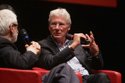 Richard Gere and  Claudio Masenza speak on stage after the Days Of Heaven screening during the 6th International Rome Film Festival at Sala Sinopoli on November 3, 2011 in Rome, Italy.