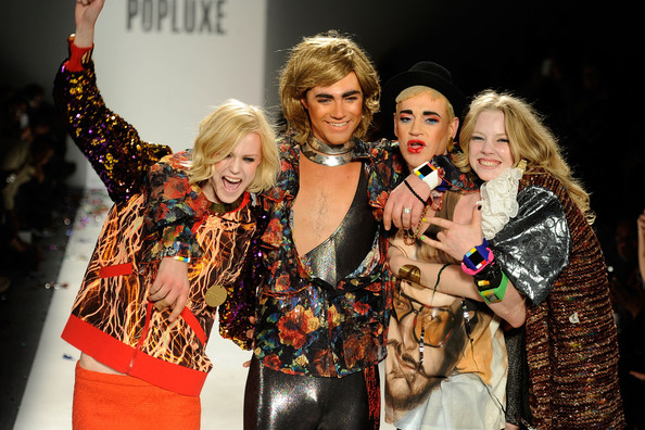 Richie Rich Models and designer Richie Rich (2nd R) walk the runway at the Popluxe Fall 2012 fashion show during Mercedes-Benz Fashion Week at The Studio at Lincoln Center on February 10, 2012 in New York City.