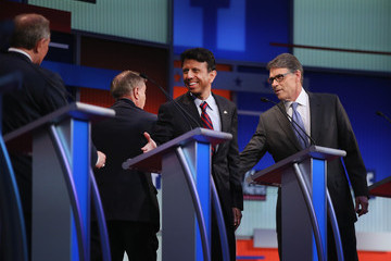 Rick Perry Bobby Jindal GOP Presidential Candidates Participate in Pre-Debate Forum in Cleveland