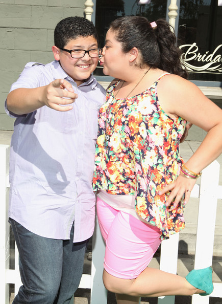 Rico Rodriguez Actors Raini Rodriguez (R) and Rico Rodriguez attend Variety's Power of Youth presented by Hasbro and GenerationOn at Universal Studios Backlot on July 27, 2013 in Universal City, California.