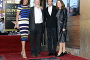 Director Ridley Scott  (2nd L), who was honored with a Hollywood Walk of Fame Star, poses with his wife Giannina Facio (L) and producer Jerry Bruckheimer and wife Linda November 5, 2015, in Hollywood, California.