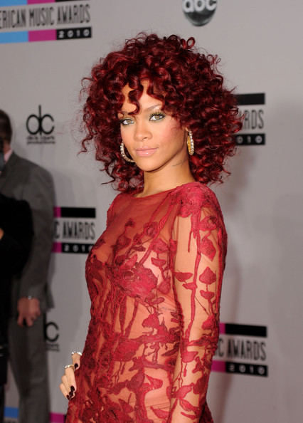 rihanna red hair curly hair. A Rihanna#39;s new sexy hair at