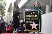 Julia Roberts (R) speaks as Rita Wilson is honored with a star on the Hollywood Walk of Fame on March 29, 2019 in Hollywood, California.