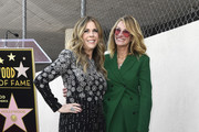 (Right) Julie Roberts poses with Rita Wilson who received  a star on the Hollywood Walk of Fame on March 29, 2019 in Hollywood, California.