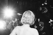 """Image was converted to black and white) Elle Fanning poses at the """"The Roads Not Taken"""" premiere during the 70th Berlinale International Film Festival Berlin at Berlinale Palace on February 26, 2020 in Berlin, Germany."""