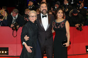 """(L-R) Director Sally Potter, Javier Bardem and Salma Hayek pose at the """"The Roads Not Taken"""" premiere during the 70th Berlinale International Film Festival Berlin at Berlinale Palace on February 26, 2020 in Berlin, Germany."""