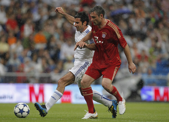 Robert Kovac Luis Figo of Real Madrid fights for the ball with Robert Kovc of Allstars Bayern Muenchen during the Corazon Classic Match between Allstars Real Madrid and Allstars Bayern Muenchen at Estadio Santiago Bernabeu on June 5, 2011 in Madrid, Spain.