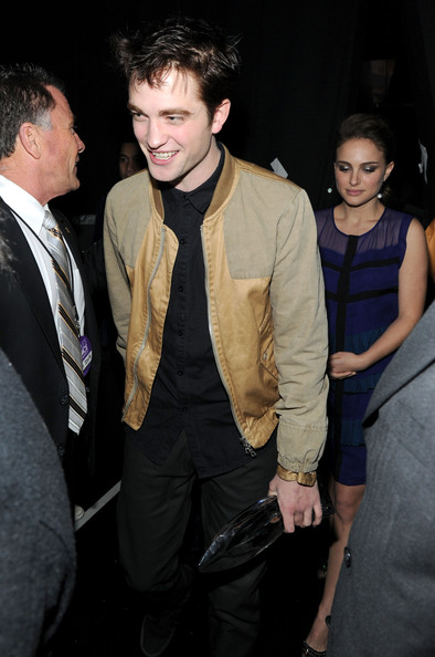 Robert Pattinson Actors Robert Pattinson (L) and actress Natalie Portman backstage at the 2011 People's Choice Awards at Nokia Theatre L.A. Live on January 5, 2011 in Los Angeles, California.