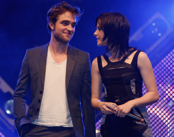 Actors Robert Pattinson and Kristen Stewart chat during the presentation of their new film The Twighlight Saga - New Moon during the HVB youth event at the Olympic Hall on November 14, 2009 in Munich, Germany.