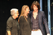(L-R) Designers Roberto Cavalli, his wife Eva Cavalli and son Daniele Cavalli acknowledge the audience at the end of the Roberto Cavalli Collection show as part of Milan Fashion Week Menswear Spring/Summer 2013 on June 24, 2012 in Milan, Italy.