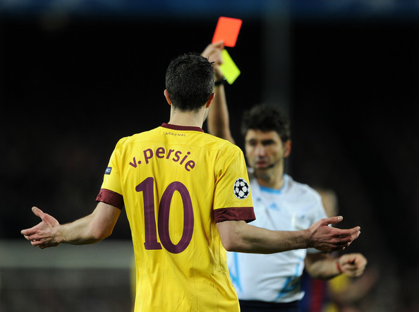 Robin Van Persie Robin van Persie of Arsenal reacts as referee Massimo Busacca shows his a red card during the UEFA Champions League round of 16 second leg match between Barcelona and Arsenal on March 8, 2011 in Barcelona, Spain.