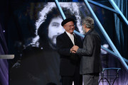 Musician Art Garfunkel (L) and inductee Cat Stevens speak onstage at the 29th Annual Rock And Roll Hall Of Fame Induction Ceremony at Barclays Center of Brooklyn on April 10, 2014 in New York City.