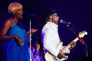 (L-R) Kimberly Davis and Nile Rodgers of Nile Rodgers & Chic perform on stage at Rock in Rio 2019 - Day 4 at Cidade do Rock on October 03, 2019 in Rio de Janeiro, Brazil.