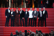 "Giles Martin, David Furnish, Bernie Taupin, Sir Elton John, Taron Egerton, Director Dexter Fletcher and Bryce Dallas Howard attend the screening of ""Rocket Man"" during the 72nd annual Cannes Film Festival on May 16, 2019 in Cannes, France."
