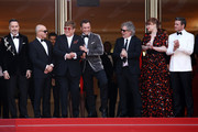 "David Furnish, Bernie Taupin, Sir Elton John, Taron Egerton, Director Dexter Fletcher and Bryce Dallas Howard attend the screening of ""Rocket Man"" during the 72nd annual Cannes Film Festival on May 16, 2019 in Cannes, France."