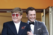 "Sir Elton John and Taron Egerton attend the screening of ""Rocket Man"" during the 72nd annual Cannes Film Festival on May 16, 2019 in Cannes, France."