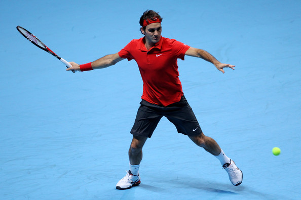 Roger Federer Roger Federer of Switzerland plays a forehand during his men's final match against Rafael Nadal of Spain during the ATP World Tour Finals at O2 Arena on November 28, 2010 in London, England.