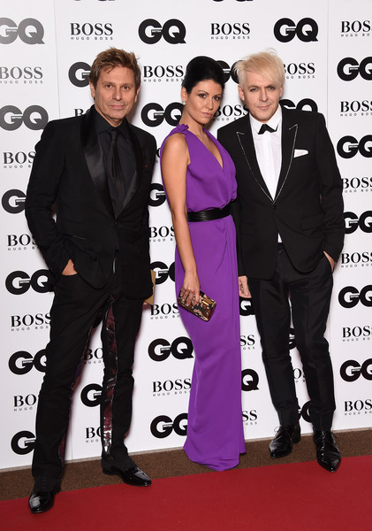Guests Arrive at the GQ Men of the Year Awards [suit,carpet,formal wear,event,red carpet,tuxedo,premiere,flooring,fashion design,style,gq men of the year awards,r-l,england,london,the royal opera house,guests,nefer suvio,roger taylorattends,nick rhodes]