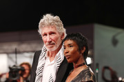 "Roger Waters and unknown guest walks the red carpet ahead of the ""Roger Waters Us + Them"" screening during the 76th Venice Film Festival at Sala Darsena on September 06, 2019 in Venice, Italy."