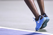 A closeup of Venus Williams' Nike shoes as she serves against Simona Halep of Romania during day four of the Rogers Cup at IGA Stadium on August 9, 2018 in Montreal, Quebec, Canada.
