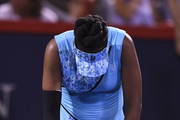 Venus Williams reacts after losing a point against Simona Halep of Romania on day four of the Rogers Cup at IGA Stadium on August 9, 2018 in Montreal, Quebec, Canada.