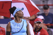 Venus Williams looks up at the rain during game stoppage against Simona Halep of Romania on day four of the Rogers Cup at IGA Stadium on August 9, 2018 in Montreal, Quebec, Canada.