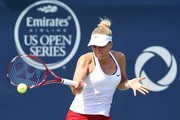 Sabine Lisicki of Germany plays a shot against Belinda Bencic of Switzerland during Day 4 of the Rogers Cup at the Aviva Centre on August 13, 2015 in Toronto, Ontario, Canada.