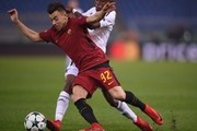 Roma's Italian striker Stephan El Shaarawy fights for the ball with Qarabag's Haitian midfielder Donald Guerrier during the UEFA Champions League Group C football match AS Roma vs FK Qarabag on December 5, 2017 at the Olympic stadium in Rome.  / AFP PHOTO / Filippo MONTEFORTE
