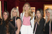 Victoria's Secret Angel Romee Strijd (C) poses with Bra Fit Experts as she hosts a bra fit event at Victoria's Secret, New Bond Street on August 22, 2018 in London, England.