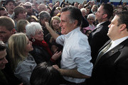 Republican presidential candidate, former Massachusetts Gov. Mitt Romney greets supporters during a campaign rally at Skyline High School on March 1, 2012 in Idaho Falls, Idaho. After winning the Michigan and Arizona primaries, Mitt Romney is campaigning in North Dakota, Idaho and Washington ahead of Super Tuesday.