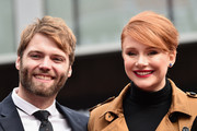 Actors Seth Gabel and Bryce Dallas Howard attend a ceremony honoring Ron Howard with the 2,568th Star on The Hollywood Walk of Fame on December 10, 2015 in Hollywood, California.