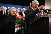 Republican Presidential candidate and U.S. Rep. Ron Paul (R-TX) (R) acknowledges supporters as his wife Carol (L) looks on during a primary night party February 28, 2012 in Springfield, Virginia. According to early exit polls, Mitt Romney has a very slim lead over Rick Santorum in Michigan's primary, with Romney projected to win the Arizona primary. Voters in Michigan and Arizona went to the polls today to pick their choice for the Republican presidential nominee.